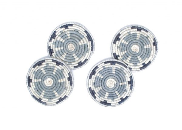 """Metallic Gray Hope Coasters, Set of 4 1 review SKU: CK.10065 Regular price $30.00 Sale price $15.00 or 4 interest-free payments of $7.50 with Afterpay ⓘ Add to cart ADD TO WISHLIST8 HANDWOVEN IN RWANDA Intricately crafted with timeless tradition, this carefully dyed sisal fiber and sweet grass fringe coaster set makes a bold and exciting statement piece. Our fringe coasters have a fun and organic look to them, making them perfect for any style decor. They can be used for your glass of wine in the evening, or on the living table when you are enjoying your early morning cup of coffee. Specifications: Care Instructions: Meaning & Purpose: Adding product to your cart Customers Also Purchased ++ Total price:$90.00 Add All to Cart This item: Metallic Gray Hope Coasters, Set of 4$30.00 10"""" Black + White Hope Trivet$30.00 10"""" Spiral Metallic Silver Hot Pad$30.00 Customer Reviews 5.0 Based on 1 Reviews 5 ★ 100% 1 4 ★ 0% 0 3 ★ 0% 0 2 ★ 0% 0 1 ★ 0% 0 100reviewers would recommend this product Write a Review Reviews KAZI Metallic Gray Hope Coasters, Set of 4 Review 02/20/2021 I recommend this product Coaster I love the coasters that I purchased. They are elegant and the quality is superb. Karla B. United States United States Share Was this helpful? 0 0 BACK TO COASTERS © 2020 KAZI. All Rights Reserved Facebook Twitter Instagram Pinterest KAZI Wholesale Customize Our Story Journal Press SHIPPING Shipping & Returns Exchanges FAQs MORE Terms & Conditions Privacy Policy GET IN TOUCH Call Us: (858) 333-8484 Email Us: info@kazigoods.com 100 West 35th Street, Suite G, National City, CA 91950 USA Build A Nest Logo"""